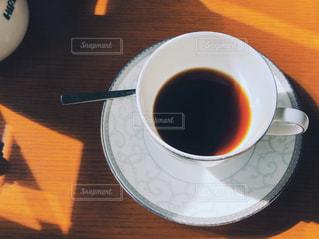 飲みかけのコーヒーの写真・画像素材[3064344]