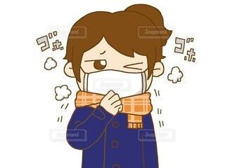 マスクをして咳をしている女性:コートの写真・画像素材[3880394]