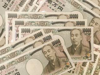 敷き詰められた一万円札の写真・画像素材[2373967]