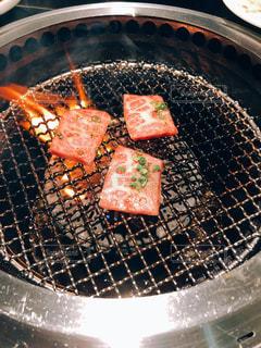 焼いてる肉。その1。の写真・画像素材[2032365]