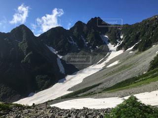 北アルプスの雪渓の写真・画像素材[2032323]