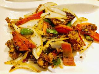 野菜と白身魚のスパイシー炒めの写真・画像素材[2115515]