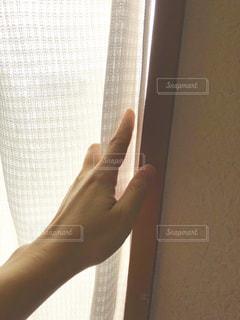 カーテン越しの夕陽1の写真・画像素材[2204560]