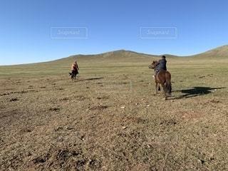 馬に乗る遊牧民の写真・画像素材[2447354]