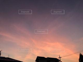 都市に沈む夕日の写真・画像素材[3579946]