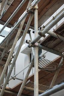 足場が組まれた住宅の工事現場の写真・画像素材[3827907]
