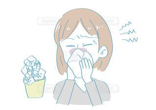 鼻をかむ女性の写真・画像素材[2436529]