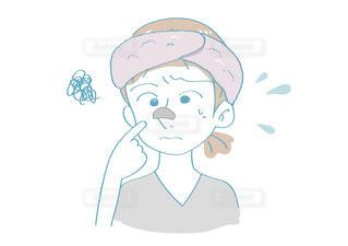 毛穴パック(黒)をする女性 悩み顔の写真・画像素材[2637989]