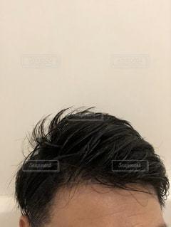 携帯電話で話している人のクローズアップの写真・画像素材[2927208]
