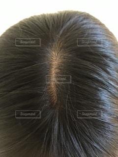 女性の顔のクローズアップの写真・画像素材[2999563]
