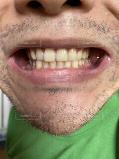 緑色の目で男の顔のクローズアップの写真・画像素材[4440612]