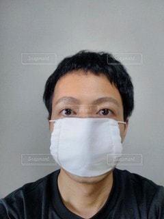アベノマスクをした男性の写真・画像素材[3297186]