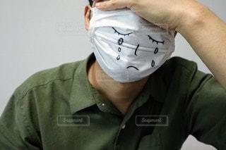 体調不良の男性の写真・画像素材[3582485]
