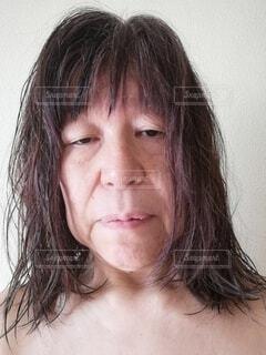六十歳の女性の疲れた顔の写真・画像素材[4141200]