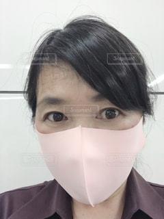 眼鏡をかけている人のクローズアップの写真・画像素材[3288934]