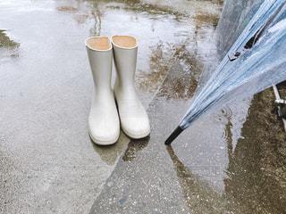 長靴とビニール傘の写真・画像素材[3058320]