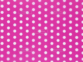 水玉 ピンク 背景の写真・画像素材[3096701]
