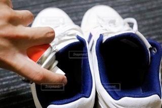 靴と消臭スプレーの写真・画像素材[3355692]