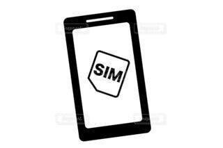 スマホとSIMカードの写真・画像素材[3879518]