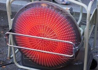 赤熱する温風ヒーターの写真・画像素材[3890577]
