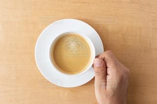 コーヒーを持つ手の写真・画像素材[3021148]