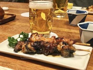 鰻の串焼きとビールの写真・画像素材[1671611]