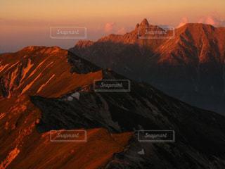 笠ヶ岳からの槍ヶ岳の夕景の写真・画像素材[3206465]