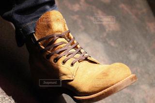 ブーツを履いた足のクローズアップの写真・画像素材[3216943]