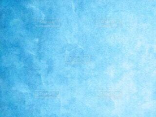明るい青のグラデーションの背景の写真・画像素材[4926664]