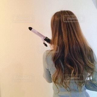巻き巻きヘアーの写真・画像素材[3712564]