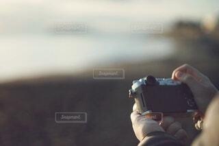 海と夕日とカメラの写真・画像素材[3857907]