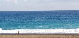 空と海と波と砂浜の写真・画像素材[3888674]
