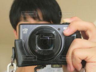 写真を撮る人の写真・画像素材[3969129]