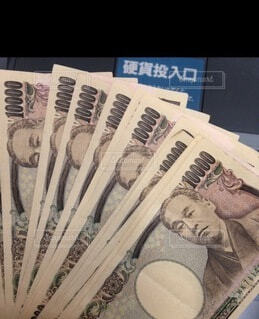 一万円札振り込みの写真・画像素材[3963105]