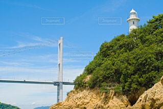来島海峡大橋と灯台の写真・画像素材[4680502]