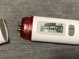 スキンチェッカーで肌の水分量を測定したところ。の写真・画像素材[2640390]