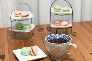 木製のテーブルにコーヒーを一杯入れたの写真・画像素材[4191132]