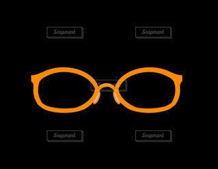 オレンジ色のメガネの写真・画像素材[4357043]