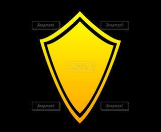 盾の黄色シルエットの写真・画像素材[4531040]