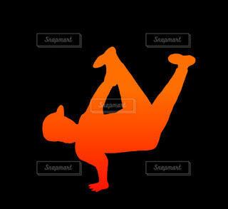 エアチェアーブレイクダンスシルエット(オレンジ)の写真・画像素材[4679078]