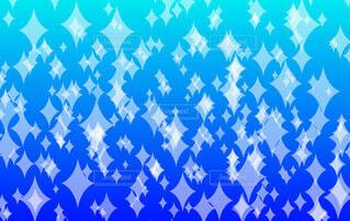 キラキラパターン(青背景)の写真・画像素材[4706232]
