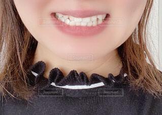 白い歯を見せる女性の写真・画像素材[4627132]
