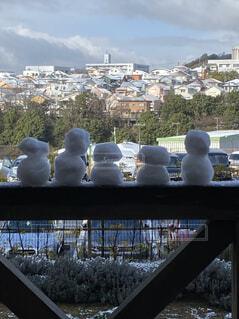 雪だるまと住宅の写真・画像素材[4617740]