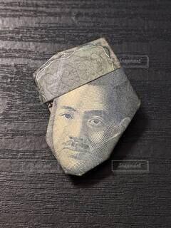 千円札折り紙。帽子をかぶった野口英世さん。の写真・画像素材[4736804]