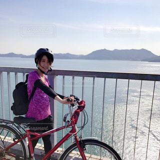 女性,1人,20代,自然,風景,アウトドア,海,空,秋,自転車,スポーツ,サイクリング