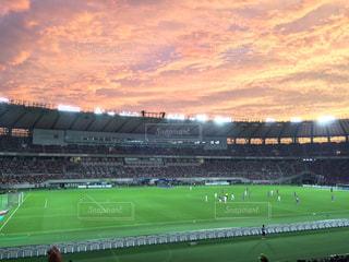 夕焼けのスタジアムの写真・画像素材[1034563]