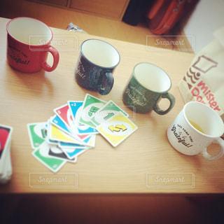 木製のテーブルの上に座ってコーヒー カップの写真・画像素材[1395214]