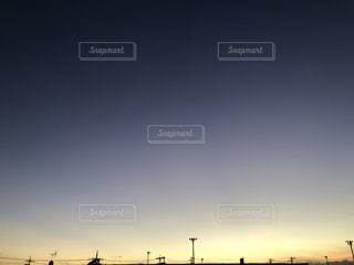 街に沈む夕日の写真・画像素材[1603811]