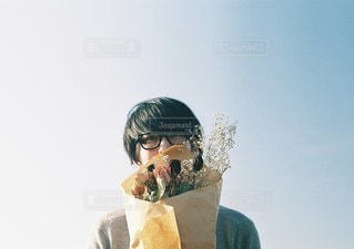 ドーナツを食べる男 - No.1107