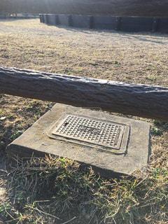柵と散水栓の写真・画像素材[1025722]